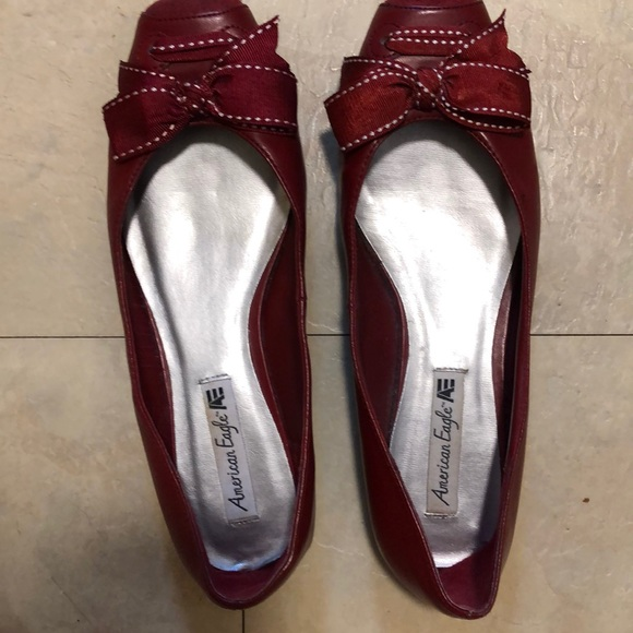 American Eagle Outfitters Shoes - American Eagle Red Flats with Ribbon Bows.